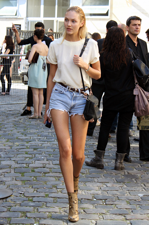 candice-swanepoel-denim-shorts-white-top-belt-purse-heels
