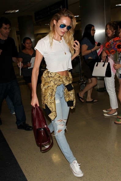 Candice Swanepoel Stella McCartney Bomber Jacket White T Shirt Ripped Jeans The Lifestyle Reporter