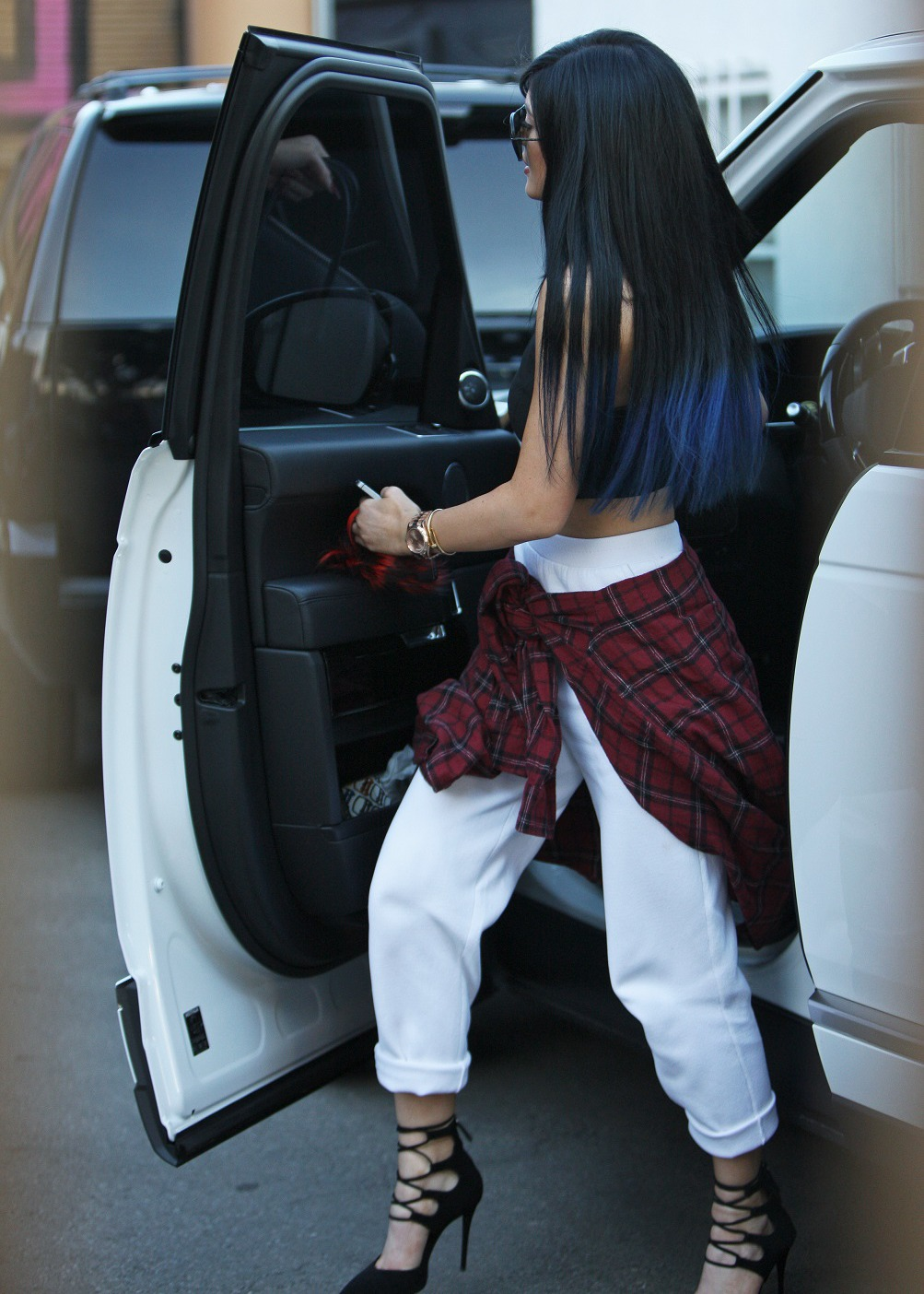 Kylie Jenner Lace Up Heels Plaid Shirt White Pants Black Crop Top