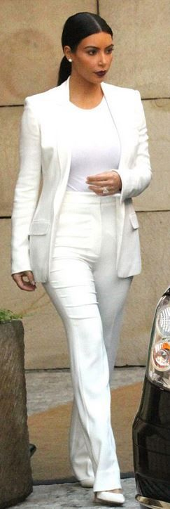 Kim Kardashian White bodysuit blazer high waisted trousers