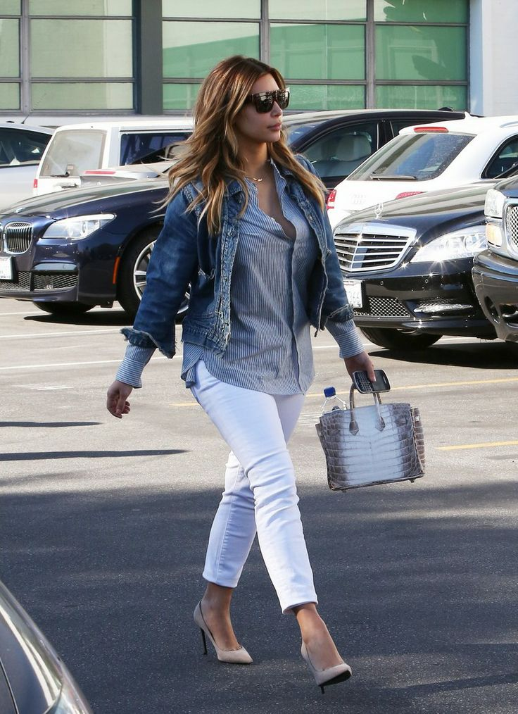 79249878a2d Kim Kardashian Denim Jacket Striped Top White Jeans Heels Birkin Bag Style