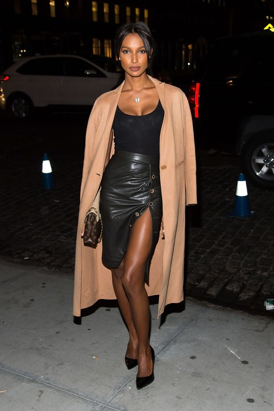 Jasmine Tookes black skirt and top beige jacket model style
