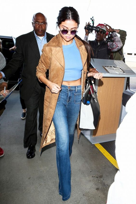 Selena Gomez crop top suede trench coat flared jeans