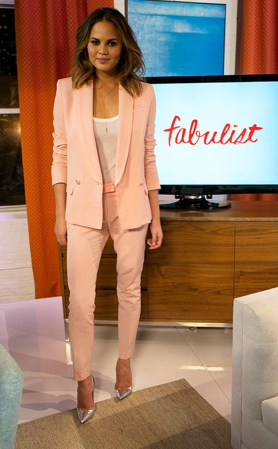 chrissy-teigen-pink-suit-with-white-tank-silver-heels